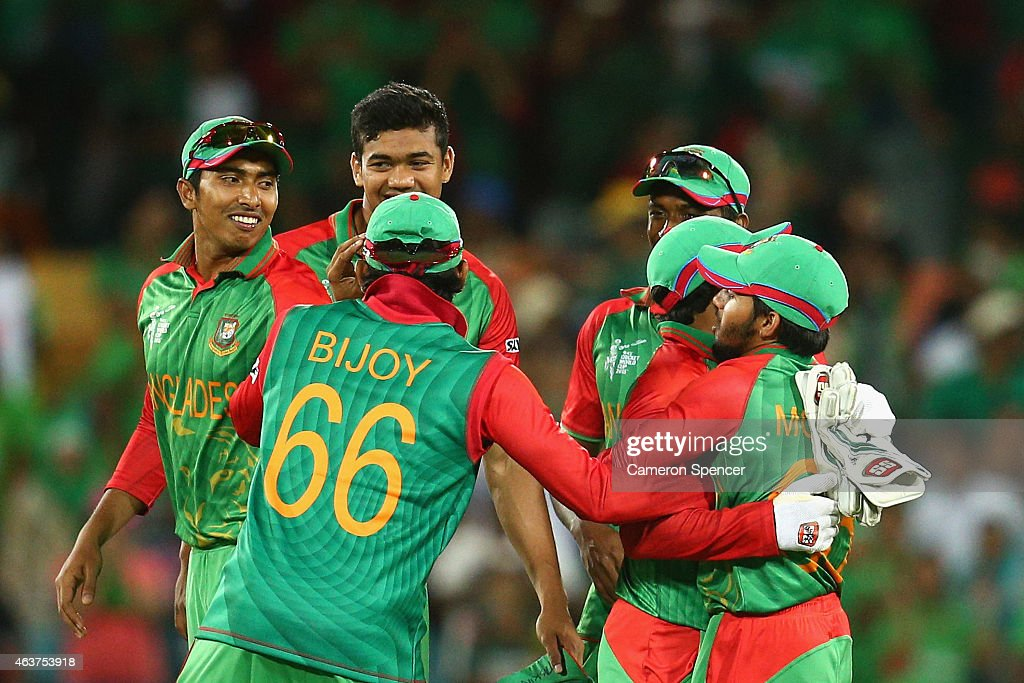 Bangladesh players celebrate winning the 2015 ICC Cricket World Cup match between Bangladesh and Afghanistan at Manuka Oval on February 18 2015 in...
