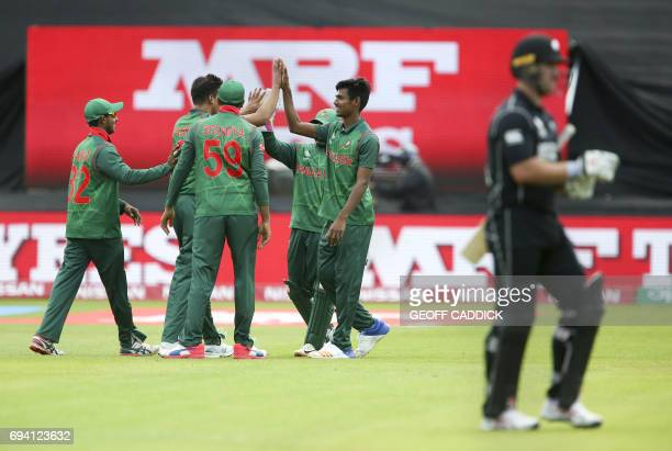 Bangladesh players celebrate with Bangladesh's Mustafizur Rahman the wicket of New Zealand's Ross Taylor during the ICC Champions Trophy match...