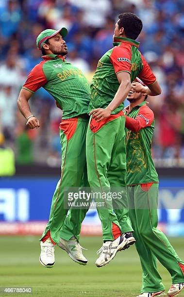 Bangladesh players Mashrafe Mortaza and Taskin Ahmed celebrate dismissing Indian batsman Ajinkya Rahane during their 2015 Cricket World Cup...