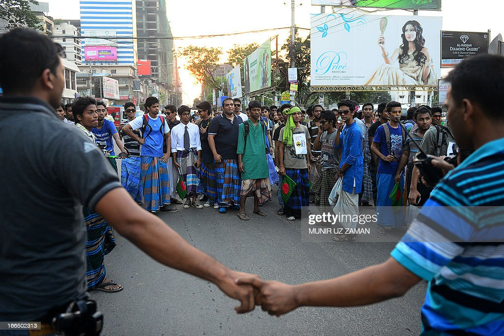 Bangladesh police stop Facebook activists as they march to protest a ban on rickshaw pullers wearing 'lungi' - traditional men's clothing - from entering Baridhara, one of the most exclusive suburbs of Dhaka on April 13, 2013. Baridhara Society, the home owner's association, has instructed security personnel not to let in rickshaw-pullers in lungi but requiring them to wear trousers, according to security men and local commuters. AFP PHOTO/Munir uz ZAMAN