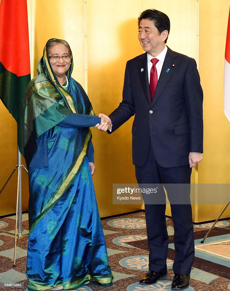 Bangladesh Prime Minister Sheikh Hasina (L) and Japanese Prime Minister <a gi-track='captionPersonalityLinkClicked' href=/galleries/search?phrase=Shinzo+Abe&family=editorial&specificpeople=559017 ng-click='$event.stopPropagation()'>Shinzo Abe</a> shake hands before their meeting in Nagoya, central Japan on May 28, 2016. Abe offered Japan's cooperation in the development of Bangladesh. ==Kyodo