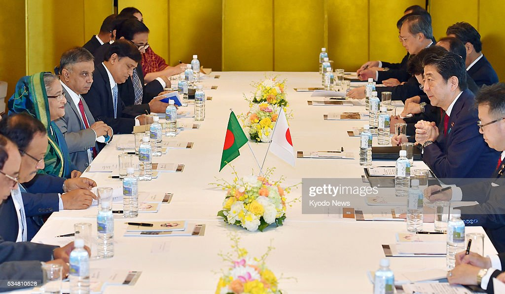 Bangladesh Prime Minister Sheikh Hasina (3rd from front, L) and Japanese Prime Minister <a gi-track='captionPersonalityLinkClicked' href=/galleries/search?phrase=Shinzo+Abe&family=editorial&specificpeople=559017 ng-click='$event.stopPropagation()'>Shinzo Abe</a> (2nd from front, R) hold talks in Nagoya, central Japan on May 28, 2016. Abe offered Japan's cooperation in the development of Bangladesh.
