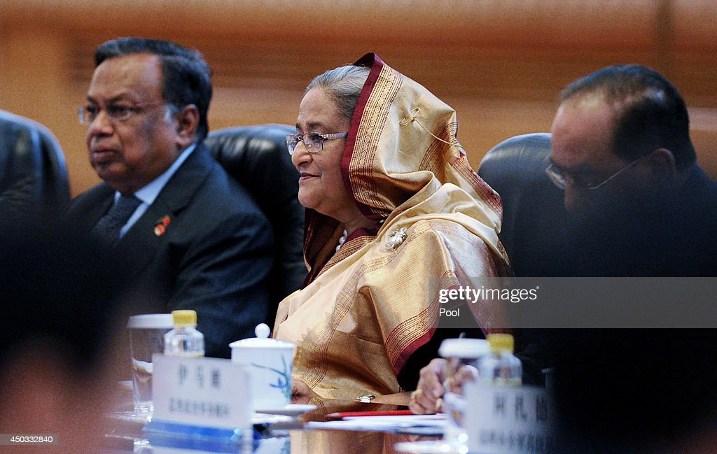 Bangladesh Prime Minister Sheikh Hasina (C) attends a signing ceremony with Chinese Premier Li Keqiang (3rd R) at the Great Hall of the People on June 9, 2014 in Beijing, China. Hasina will be in China from June 6 to 11.