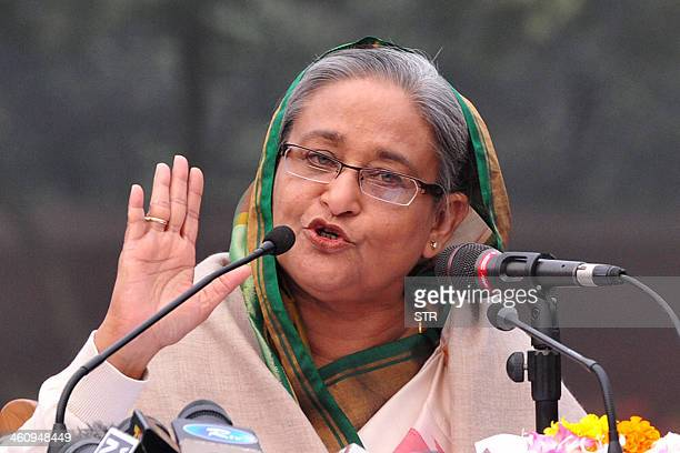 Bangladesh Prime Minister Sheikh Hasina gestures while speaking during a press conference after the national election in Dhaka on January 6 2014...