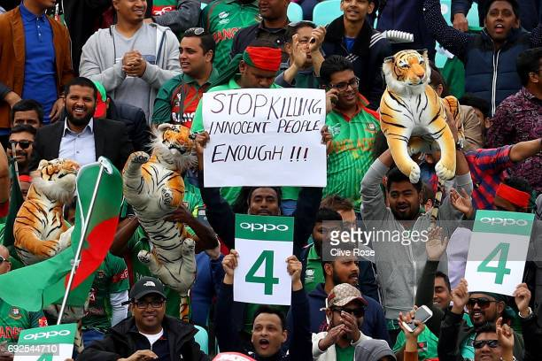 Bangladesh supporter holds up a sign referencing the recent terror attacks during the ICC Champions trophy cricket match between Australia and...