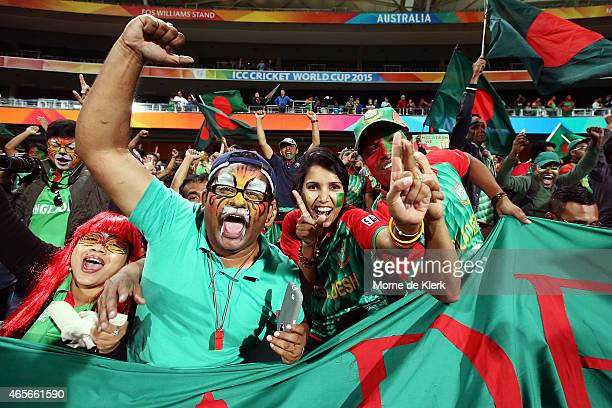 Bangladesh supporters celebrate after the 2015 ICC Cricket World Cup match between England and Bangladesh at Adelaide Oval on March 9 2015 in...