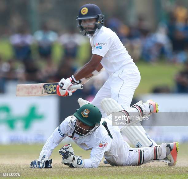 Bangladesh wicketkeeper Liton Das takes a catch to dismiss Sri Lanka's Niroshan Dickwella during the fourth day of the opening Test match between Sri...