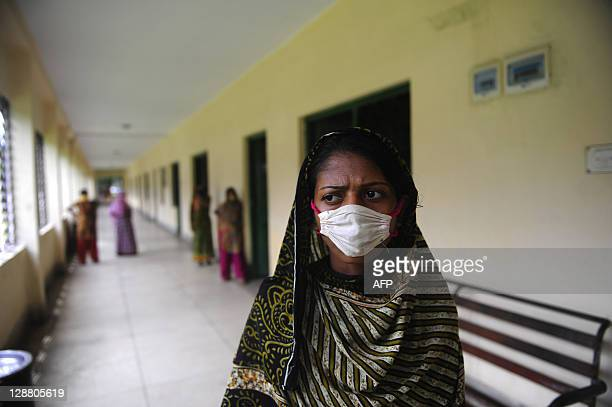BangladeshhealthrightsgarmentFEATURE by Shafiq Alam Bangladeshi garment labourer Asma who once worked in a sandblasting factory poses in the...