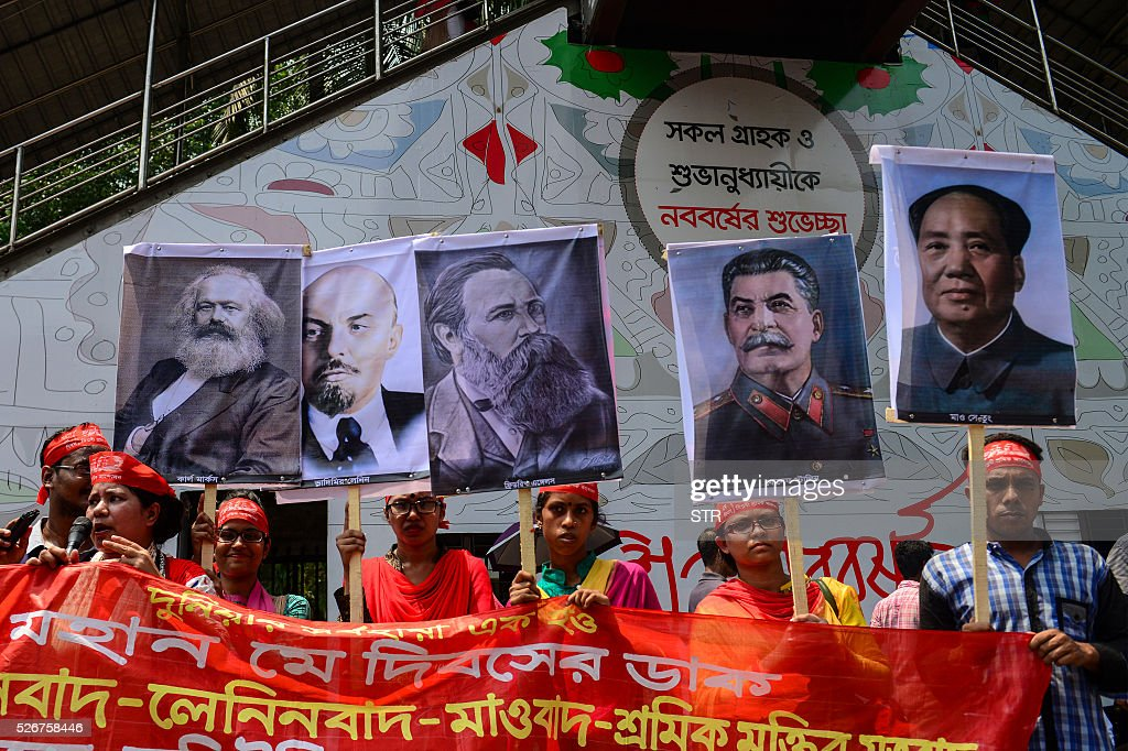 Bangladeshi activists and workers shout slogans and hold a banner and portraits during a procession to mark May Day or International Workers Day in Dhaka on May 1, 2016. Activists around the world mark international workers' day with marches demanding better working conditions, more jobs and higher wages. / AFP / STR