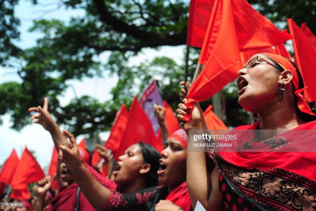 Bangladeshi activists shout slogans and wave flags during a procession to mark May Day or International Workers Day in Dhaka on May 1, 2013. Tens of thousands of Bangladeshis joined May Day protests Wednesday to demand the execution of textile bosses over the collapse of a factory complex, as rescuers warned the final toll could be more than 500. AFP PHOTO/Munir uz ZAMAN