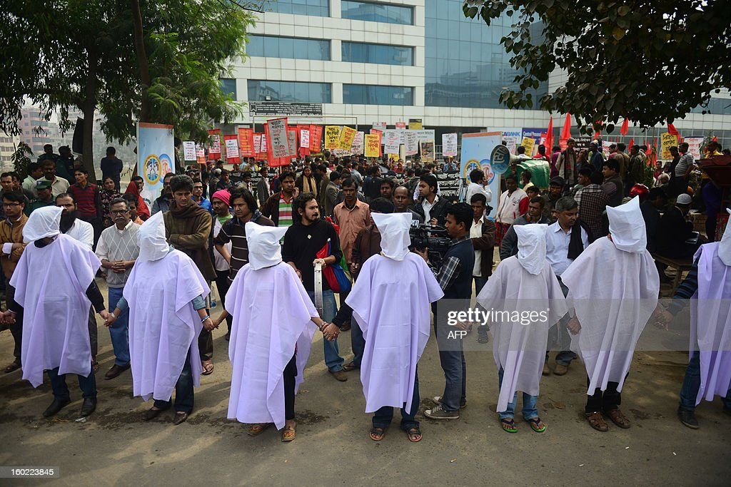 Bangladeshi activists wear death shrouds during a protest in front of the Bangladesh Garment Manufactures & Exporters Association (BGMEA) office in Dhaka on January 28, 2013. Garment workers demanded an increase to their wages and an improvement in their work environment. Around 700 people have been killed in garment factory fires in the country since 2006. AFP PHOTO/ Munir uz ZAMAN