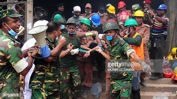 Bangladeshi army personal carry a survivor that was recovered three days after an eightstorey building collapsed in Savar on the outskirts of Dhaka...