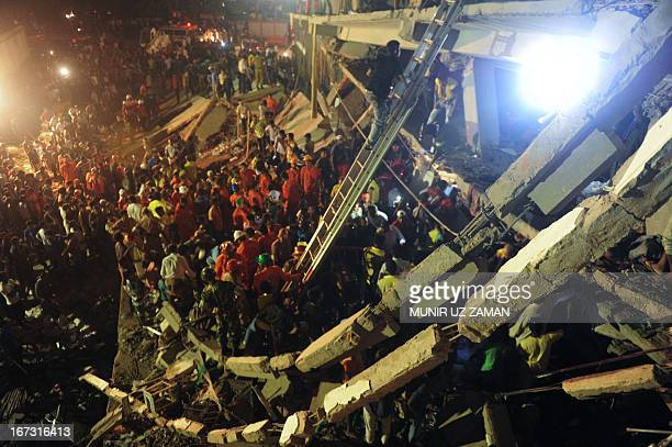 Bangladeshi Army personnel and civilian volunteers work on the scene at a building collapse in Savar on the outskirts of Dhaka on April 24 2013 An...