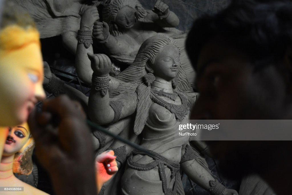 A Bangladeshi artist works on an idol of the Hindu God Biswakarma in Dhaka , Bangladesh on August 18, 2017. Biswakarma is the hindu god of architecture and machinery and worshiped across the country on September 17, 2017.