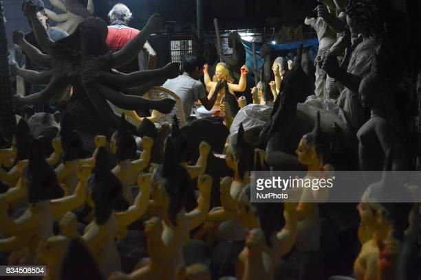 A Bangladeshi artist works on an idol of the Hindu God Biswakarma in Dhaka Bangladesh on August 18 2017 Biswakarma is the hindu god of architecture...