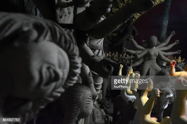 Bangladeshi artists preparing clay idol of Hindu deity Durga and God Biswakarma in Dhaka Bangladesh on August 18 2017 for upcoming Hindu festival...