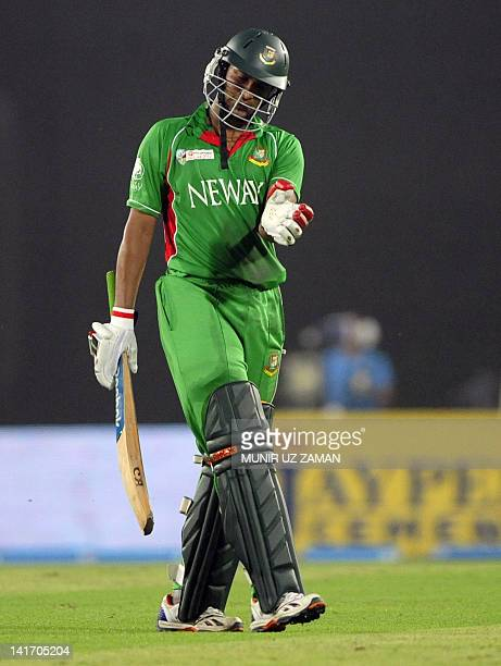 Bangladeshi batsman Shakib Al Hasan leaves the field after being dismissed by the unseen Pakistan Aizaz Cheema during the one day international Asia...