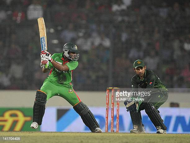 Bangladeshi batsman Shakib Al Hasan plays a shot as the Pakistan's wicketkeeper Sarfraz Ahmed looks during the one day international Asia Cup cricket...