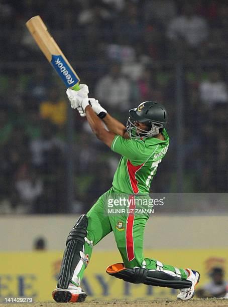 Bangladeshi batsman Shakib Al Hasan plays a shot during the one day international Asia Cup cricket match between India and Bangladesh at the...