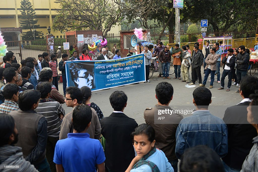 Bangladeshi bloggers participate in a protest action in Dhaka on January 16, 2013. A self-styled 'militant atheist' who is famed for his anti-religious blogs was fighting for life after he was stabbed in the capital of Muslim-majority Bangladesh, police and medics said. Asif Mohiuddin, 29, was attacked on the night of January 14 by three unidentified men near his office in Dhaka's upscale Uttara district. AFP PHOTO/Munir uz ZAMAN