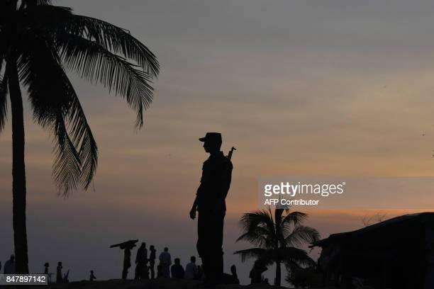 A Bangladeshi Border Guard stands guard near the beach of Sharapuri Dwip on September 16 2017 Bangladesh Prime Minister Sheikh Hasina headed for the...