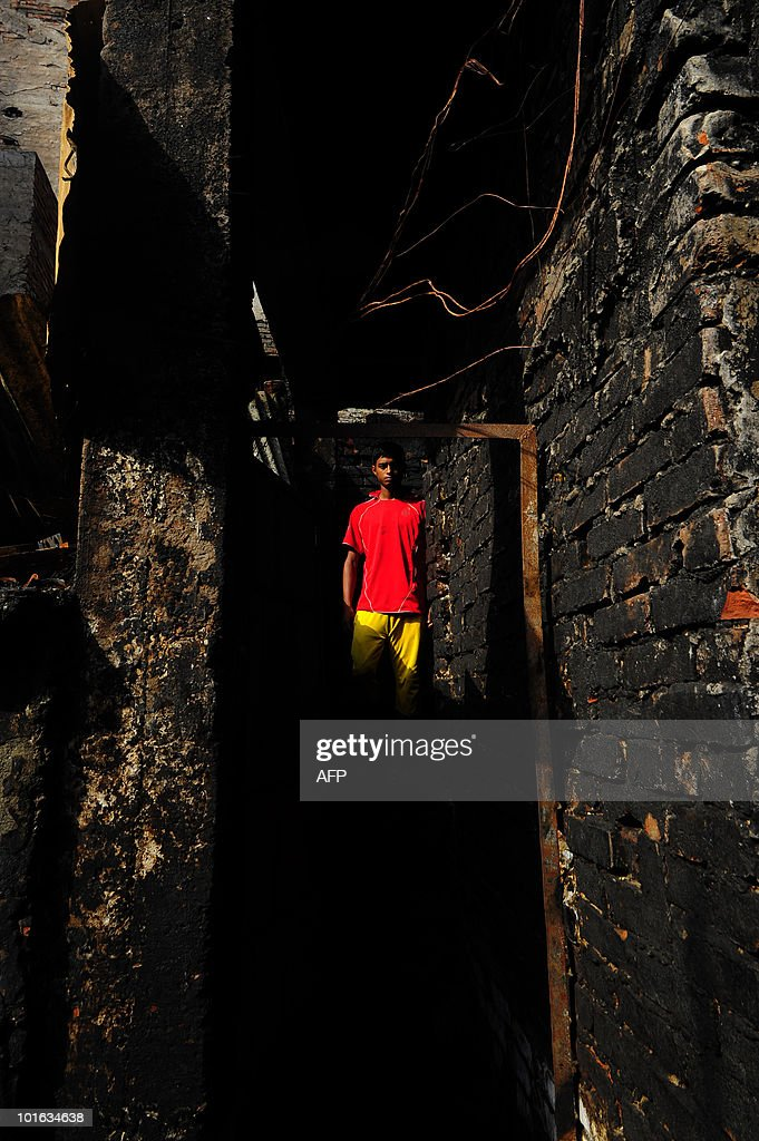 A Bangladeshi boy walks through the site of a burnt-out house in Old Dhaka on June 5, 2010. The national flag flew at half-mast and people of all faiths joined prayers as Bangladesh mourned the deaths of nearly 120 people in the country's deadliest blaze.