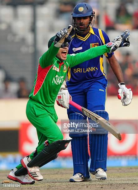 Bangladeshi captain Mushfiqur Rahim reacts after the dismissal of Sri Lankan batsman Lahiru Thirimanne during the one day international Asia Cup...