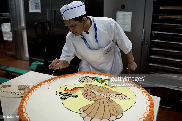 Bangladeshi cook decorates a Thanksgiving cake at Sather Airforce Base November 24 2011 is the last Thanksgiving US troops will be celebrating before...