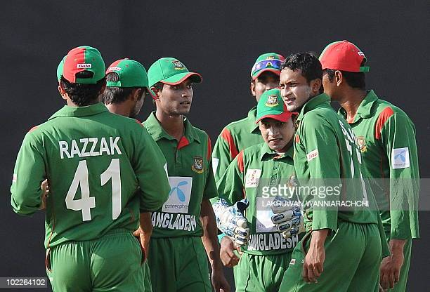 Bangladeshi cricket captain Shakib Al Hasan celebrates with teammates after dismissing unseen Pakistani cricketer Imran Farhat during the fifth One...
