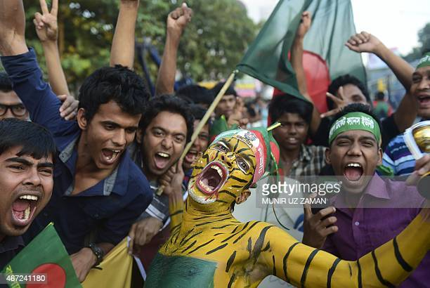 Bangladeshi cricket fans shout as they wait to welcome the Bangladesh cricket team at the Hazrat Shahjalal International Airport in Dhaka on March 22...