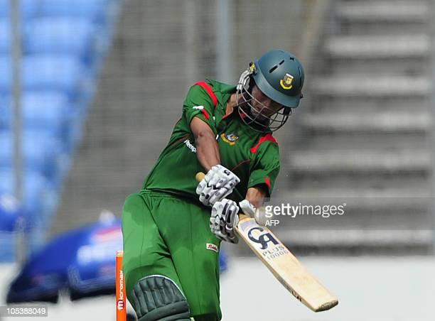 Bangladeshi cricket team captain Shakib Al Hasan plays a shot during the fourth onedayinternational match between Bangladesh and New Zealand at Shere...