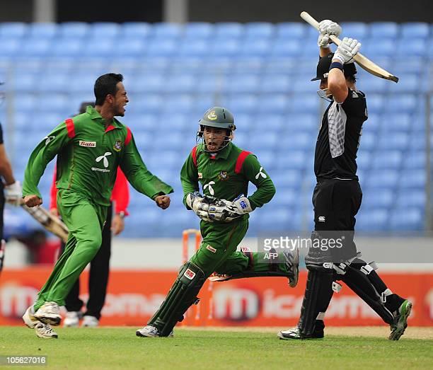 Bangladeshi cricket team captain Shakib Al Hasan watches as his teammate Mushfiqur Rahim runs after the dismissal of the New Zealand cricketer Nathan...