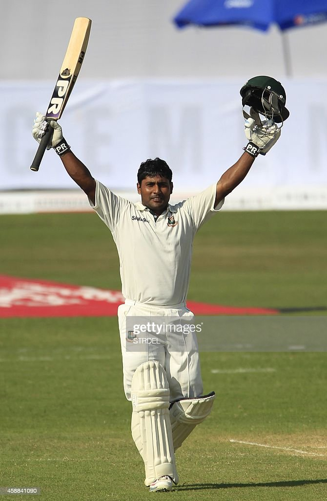 Bangladeshi cricketer Imrul Kayes reacts after scoring a century during the first day of the third cricket Test match between Bangladesh and Zimbabwe...