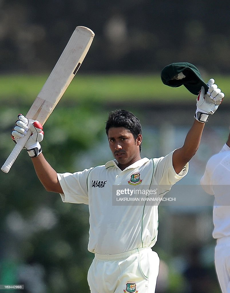 Bangladeshi cricketer Mohammad Ashraful raises his bat as he acknowledges the crowd after completing 150 runs during the third day of the opening...