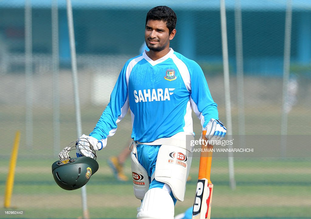 Bangladeshi cricketer Mohammad Mahmudullah carries his equipment during a practice session at the Uyanwatte Stadium in the southern town of Matara on March 2, 2013. Bangladesh will play two Tests, three one-dayers and one Twenty20 match during their month-long tour of Sri Lanka, with the first Test starting at Galle on March 8.