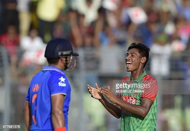 Bangladeshi cricketer Mustafizur Rahman reacts after the dismissal of the Indian cricketer Suresh Raina during the second ODI cricket match between...