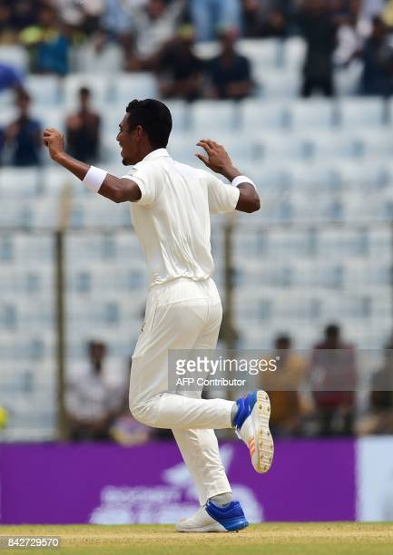 Bangladeshi cricketer Mustafizur Rahman reacts after the dismissal of the Australian cricketer Matt Renshaw during the second day of the second...