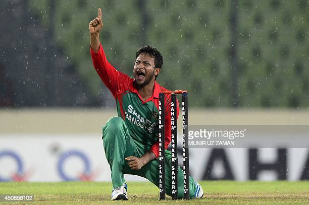 Bangladeshi cricketer Shakib Al Hasan makes an unsuccessful appeal during the third and final One Day International cricket match between India and...