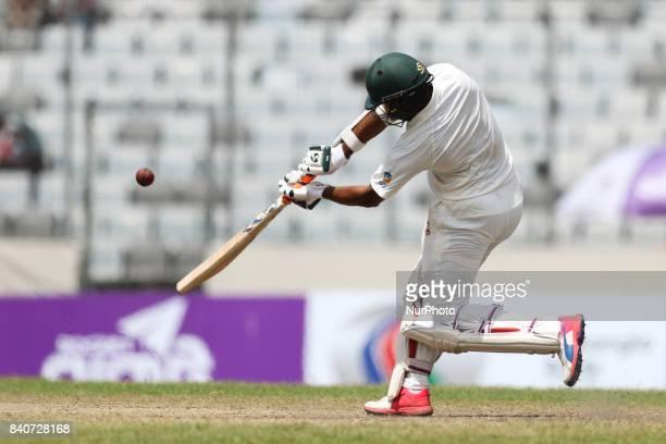 Bangladeshi cricketer Shakib Al Hasan plays a shot during the third day of the first Test cricket match between Bangladesh and Australia at the...