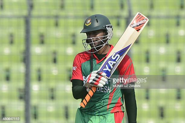 Bangladeshi cricketer Shakib Al Hasan reacts after scoring a halfcentury during the One Day International cricket match between India and Bangladesh...