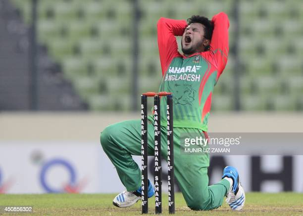 Bangladeshi cricketer Shakib Al hasan reacts as he appeals unsuccessfully for a leg before wicket decision against Cheteshwar Pujara during the third...