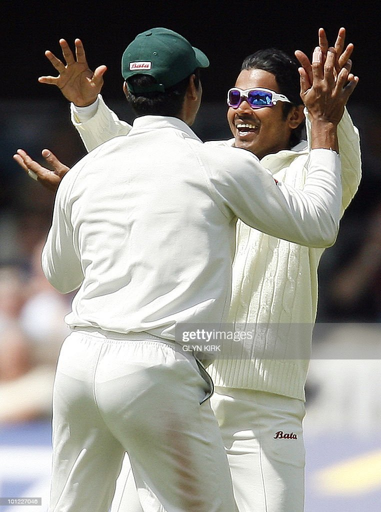 Bangladeshi cricketer Shamsur Rahman (R) celebrates the wicket of England's Matthew Prior (not pictured) run out for 16 runs, on the second day of the first Test match against England at Lord's Cricket Ground in London, on May 28, 2010.
