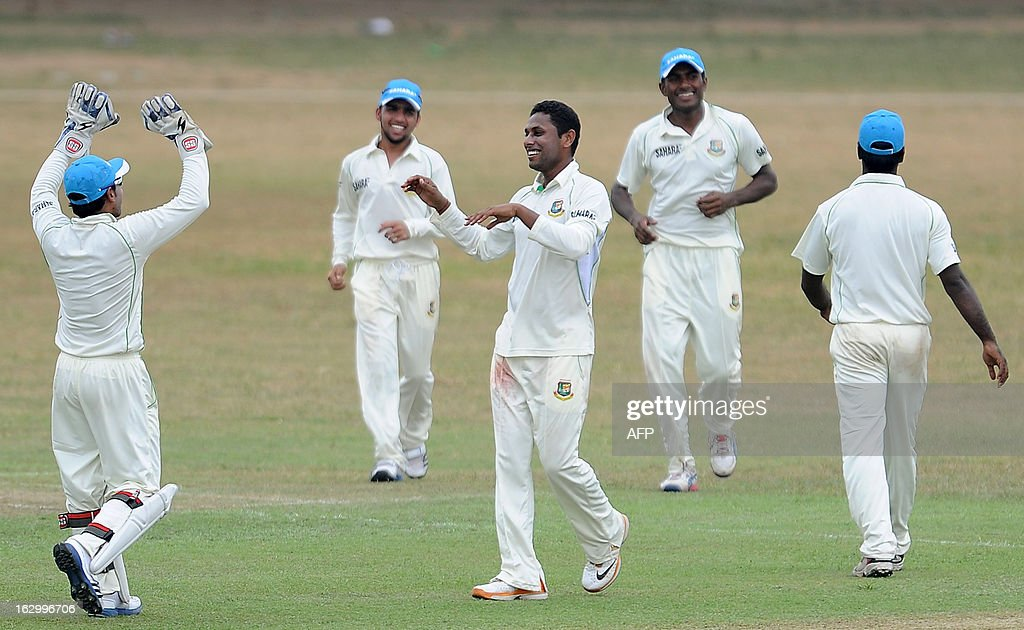 Bangladeshi cricketer Sohag Gazi (C) celebrates with his teammates after he dismissed unseen Sri Lanka Development Emerging cricketer Ashan Priyanjan during the first day of a three day practice match between the Sri Lanka Development Emerging Team and Bangladesh at the Uyanwatte Stadium in Matara on March 3, 2013.