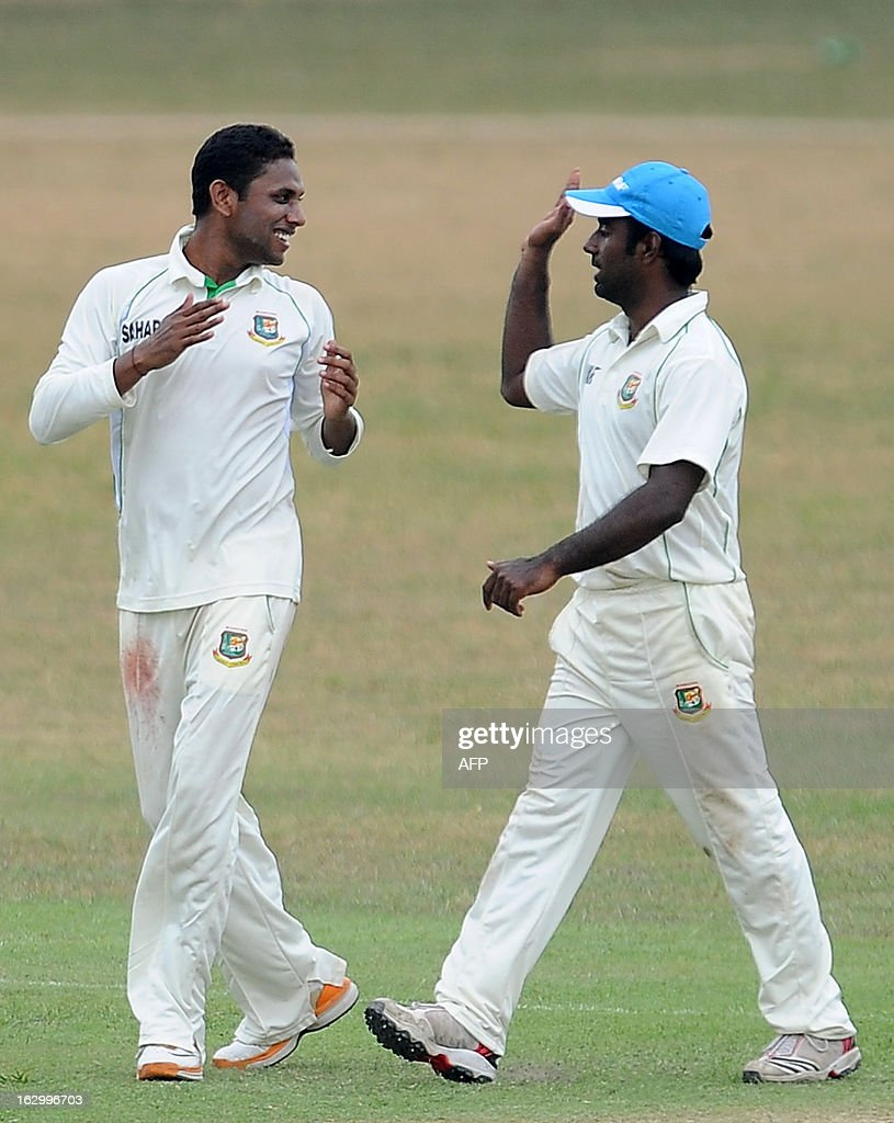 Bangladeshi cricketer Sohag Gazi (L) celebrates with teammate Elias Sunny (R) after he dismissed unseen Sri Lanka Development Emerging cricketer Ashan Priyanjan during the first day of a three day practice match between the Sri Lanka Development Emerging Team and Bangladesh at the Uyanwatte Stadium in Matara on March 3, 2013.