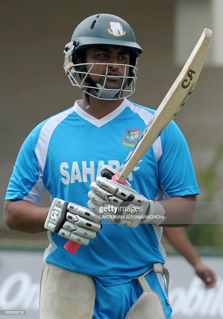 Bangladeshi cricketer Tamim Iqbal inspects his bat during a practice session at the Galle International Cricket Stadium in Galle on March 7, 2013. Bangladesh will play two Tests, three one-dayers and one Twenty20 during their month-long tour of Sri Lanka, with the first Test starting at Galle on March 8.
