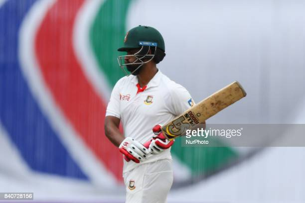 Bangladeshi cricketer Tamim Iqbal leaving the pitch after the dismassal during the third day of the first Test cricket match between Bangladesh and...