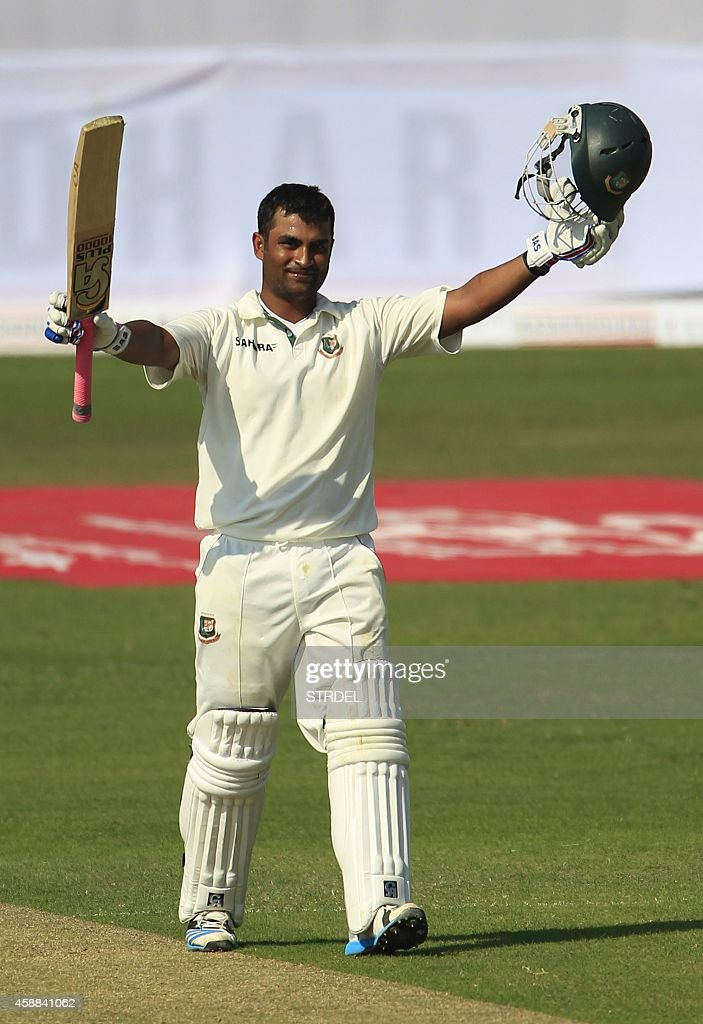 Bangladeshi cricketer Tamim Iqbal reacts after scoring a century during the first day of the third cricket Test match between Bangladesh and Zimbabwe...