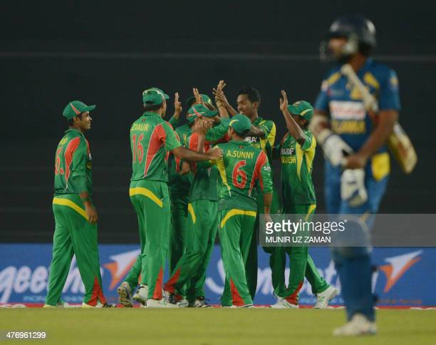 Bangladeshi cricketers celebrate after the dismissal of Sri Lankan cricketer Kusal Perera during the tenth match of the Asia Cup oneday cricket...