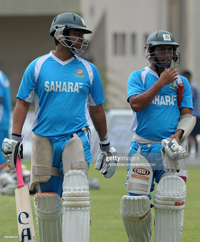 Bangladeshi cricketers Tamim Iqbal (L) and Mohammad Ashraful (R) walk during a practice session at the Galle International Cricket Stadium in Galle on March 7, 2013. Bangladesh will play two Tests, three one-dayers and one Twenty20 during their month-long tour of Sri Lanka, with the first Test starting at Galle on March 8. AFP PHOTO/ LAKRUWAN WANNIARACHCHI