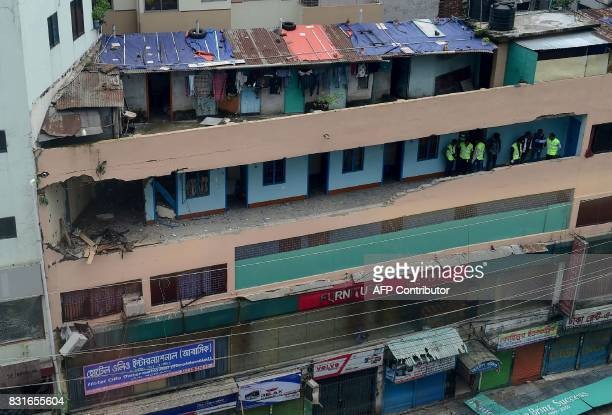 Bangladeshi crime scene investigators collect evidence from a hotel after a raid on a militant hideout in Dhaka on August 15 2017 An Islamist...